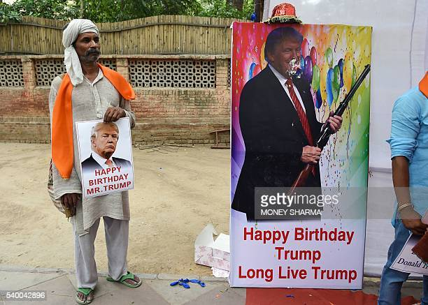 An Indian rightwing Hindu activist hold takes part in celebrations to mark the 70th birthday of US Republican presidential candidate Donald Trump in...