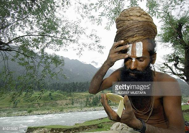 An Indian Sadhu adorns his forehead with religious markings at Pahalgam some 55 kms east of Srinagar, 15 July 2004, during the annual pilgrimage to a...