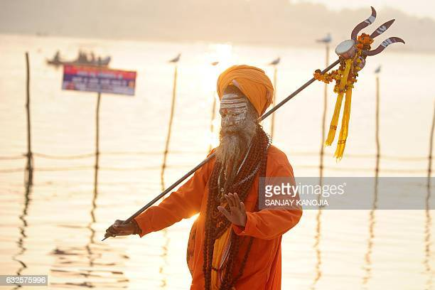 An Indian sadhu arrives at Sangam during the Magh Mela festival in Allahabad on January 24 2017 The Magh Mela is held every year on the banks of...