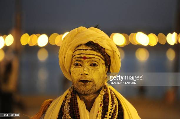 TOPSHOT An Indian Sadhu looks on as he walks on the banks of the Sangam during the Magh Mela festival in Allahabad on February 7 2017 / AFP PHOTO /...