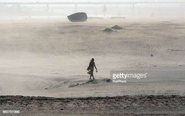 An indian sadhu pass through a heavy dust storm in Allahabad on March 302017