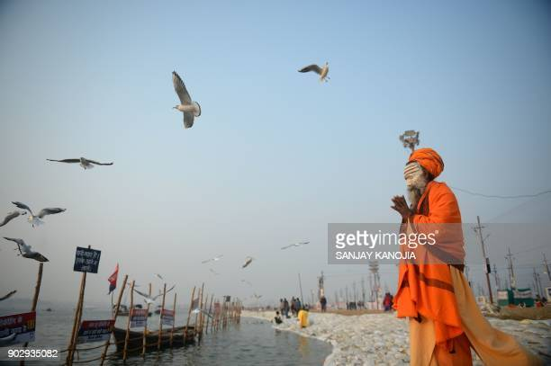 TOPSHOT An Indian sadhu performs evening prayer at Sangam during the Magh Mela festival in Allahabad on January 9 2018 The Magh Mela is held every...