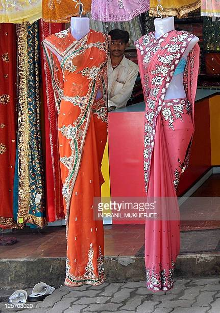 An Indian salesman waits for customers at a garment store in Mumbai on September 20, 2011. India's benchmark wholesale price index -- the closest...
