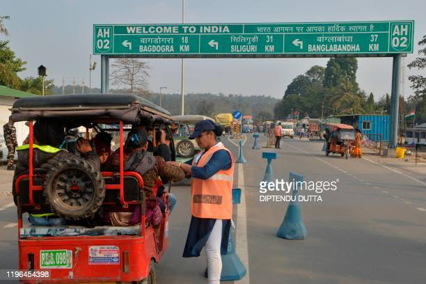 An Indian Sashastra Seema Bal personal checks travellers coming from Nepal to India during a Corona virus information camp at an IndiaNepal border...