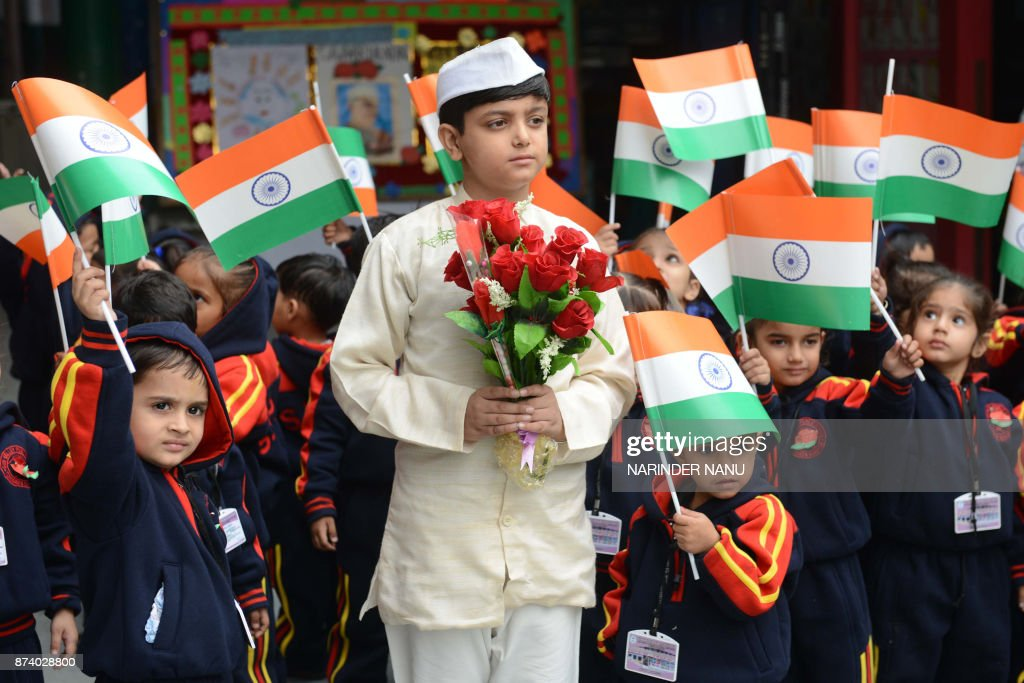 An Indian school boy dressed as India`s former first prime minister Jawaharlal Nehru poses during celebrations of Children`s Day at a school in...