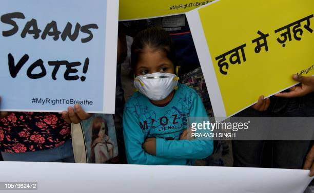 TOPSHOT An Indian school girl wearing a mask takes part in the awareness drive 'My Right to Breathe' to protest high levels of air pollution in New...