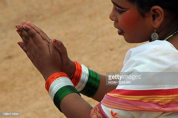 An Indian school student of Southern state of Andhra Pradesh wearing tricolour bangles participates in the 55th AP formation day celebrations amidst...