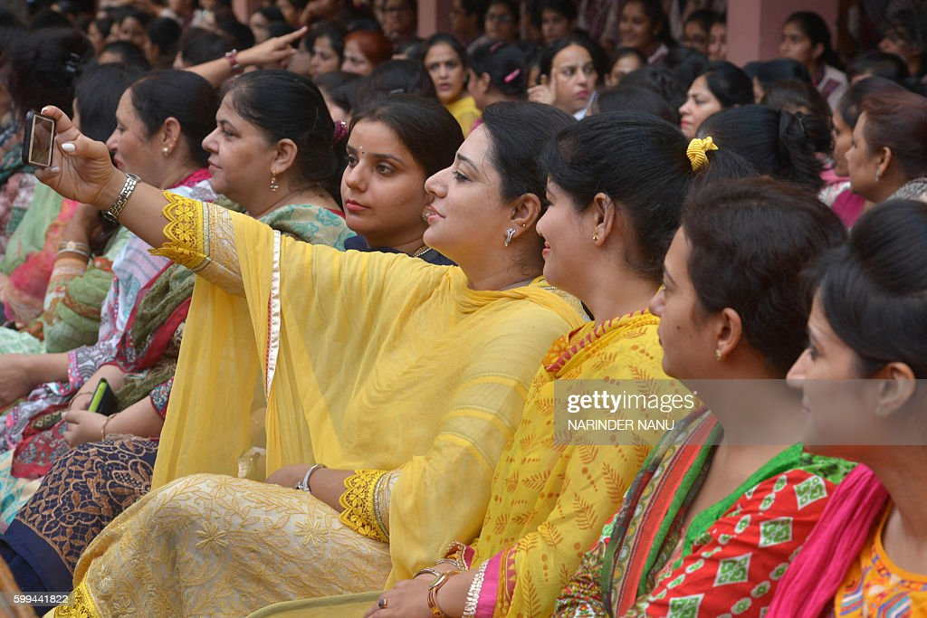 An Indian school teacher takes a selfie during celebrations for `Teacher`s Day` at a school in Amritsar on September 5 2016 September 5 is the birth..