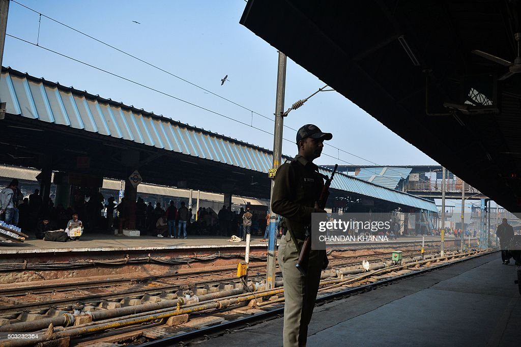 An Indian security official stands alert on a platform at New Delhi Railway Station in New Delhi on January 3 following a bomb scare after an attack..
