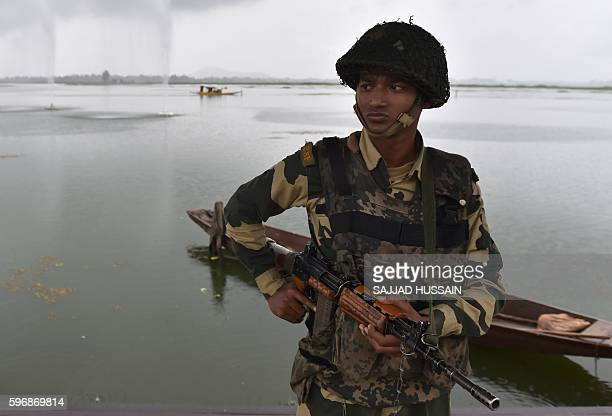 An Indian security personnel stands guard at Dal Lake during curfew in Srinagar on August 28 2016 Indianadministered Kashmir has been in the grip of...