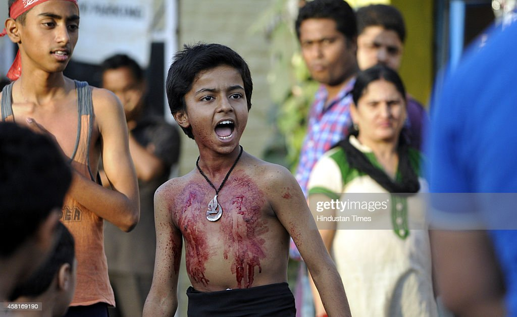 Non Muslim Perspective On The Revolution Of Imam Hussain: An Indian Shiite Muslim Boy Bleeds After Flagellating