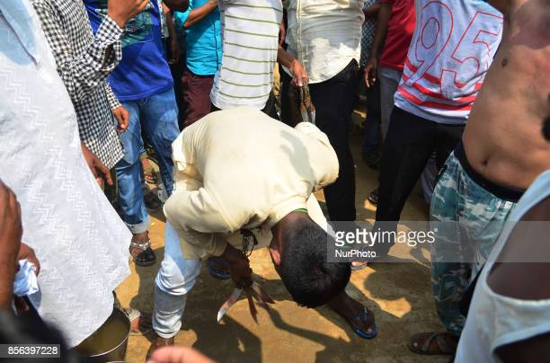 An Indian shiite muslim flagellates on his head with blades during a religious procession to mark Ashura in Allahabad on October 12017 The mourning...