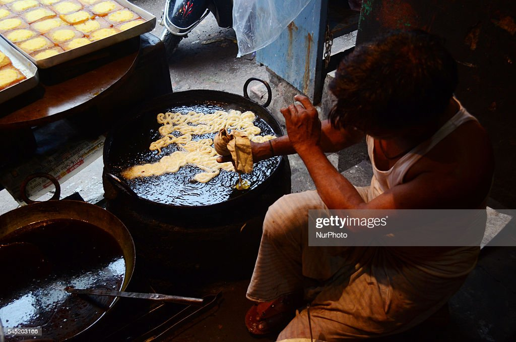 Must see Indian Eid Al-Fitr Feast - an-indian-shopkeeper-makes-traditional-sweet-dish-in-a-local-street-picture-id545203166  Collection_607450 .com/photos/an-indian-shopkeeper-makes-traditional-sweet-dish-in-a-local-street-picture-id545203166
