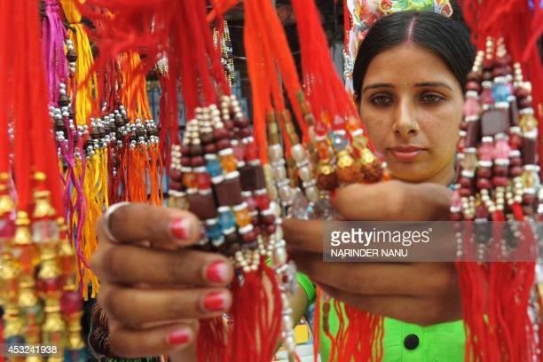 An Indian shopper looks at 'rakhi' ahead of the Hindu festival Raksha Bandhan in Amritsar on August 6 2014 The annual festival of Raksha Bandhan...