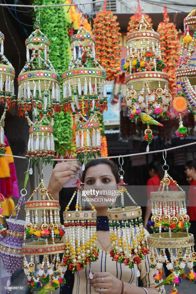 An Indian Shoppers Looks For Decoration Items On The Eve Of The