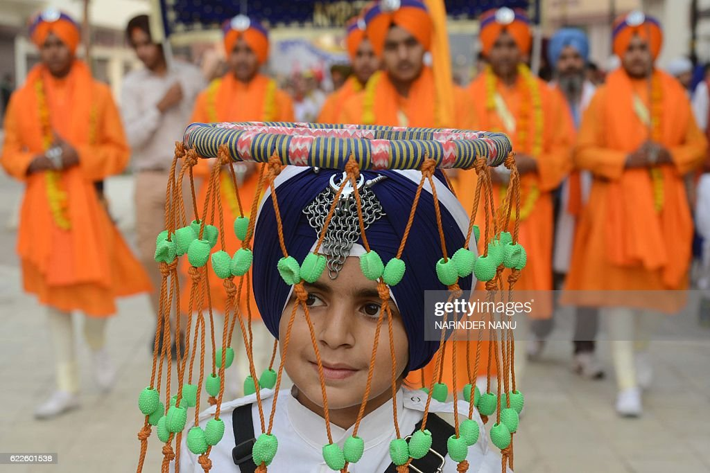 An Indian Sikh boy waits to demonstrate `Gatka` martial arts skills during a procession from the Sri Akal Takhat at the Golden Temple in Amritsar on..
