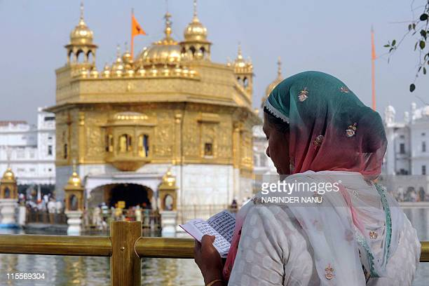 An Indian Sikh devotee reads the Nitnem Gutka holy book at the Sikh shrine the Golden temple in Amritsar on June 5 2011 Indian Sikh's celebrated the...