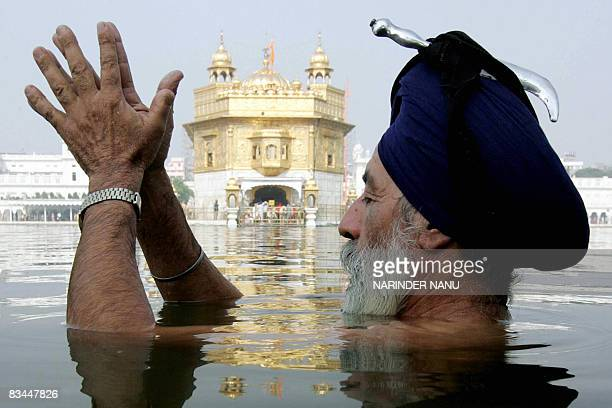 An Indian Sikh offers prayers at the Golden temple on the eve of the festival of Bandi Chhor Divas in Amritsar on October 27 2008 BandiChhor Divas...