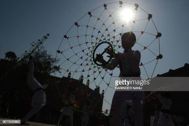 TOPSHOT An Indian Sikh participant performs 'Gatka' an ancient form of Sikh martial art during a competition in Amritsar on January 20 2018 Gatka is...