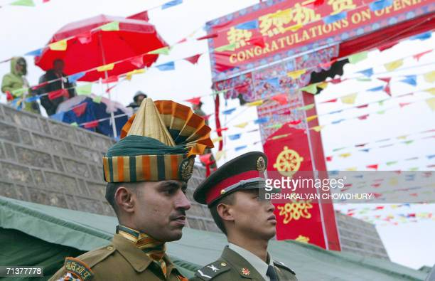 An Indian soldier and his Chinese counterpart stand still before a ceremony marking the reopening of the ChinaIndia border at the 15000feet Nathu La...