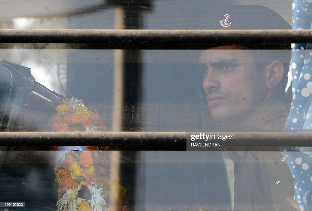 An Indian soldier, holding a wreath, waits inside a military truck for the arrival of the bodies of two comrades, allegedly killed by Pakistani soldiers in a cross-border skirmish in the disputed Kashmir region, at the New Delhi Air Force Station on January 9, 2012. India delivered a dressing-down to Islamabad's envoy to Delhi as it accused Pakistan's army of beheading one of two soldiers killed in Kashmir, but both sides warned against inflaming tensions.