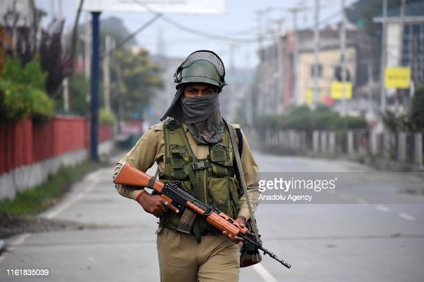 An Indian soldier holds an assault rifle as he stands alert outside the venue of India's Independence Day celebration in Srinagar Kashmir on August...
