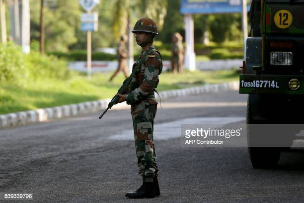 An Indian soldier looks on as he stands guard at Panchkula on August 26 after followers of controversial guru Ram Rahim Singh on August 25 went on a...