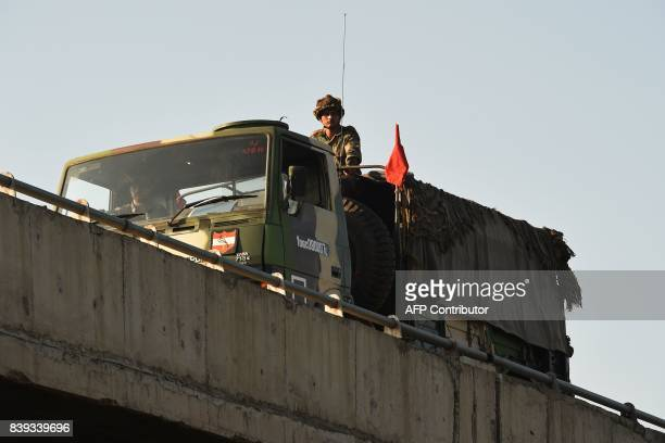 An Indian soldier looks on from an army truck at Panchkula on August 26 after followers of controversial guru Ram Rahim Singh on August 25 went on a...