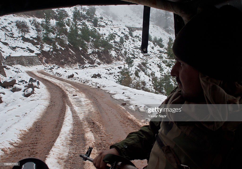 An Indian soldier patrols in his vehicle on a road which leads to the posts of Indian army by Churunda village on January 12, 2013, northwest of Srinagar, the summer capital of Indian Administered Kashshmir, India. The village with a population of a little over 12,000 people has been bearing the brunt of cross-fire between nuclear rivals India and Pakistan. Last week a Pakistan solider was killed across the Line of Control (LOC), a military line that divides Indian-administered Kashmir from the Pakistan-administered Kashmir at this village. People living along the LoC have continually been at risk due to hostility between the armies of the two rival nations. Last year, in November, three people, including a pregnant woman, had died after a shell fired from Pakistan landed on one of the houses in the village. Tension between Pakistan and India has escalated after a fresh skimirish along the border. Both countries have summoned each other's envoy to protest against unacceptable and unprovoked' attacks.