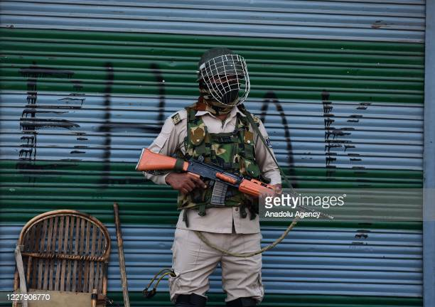An Indian soldier stands alert during curfew in Srinagar Kashmir on August 04 2020 The administration in Kashmir imposed strict curfew following the...