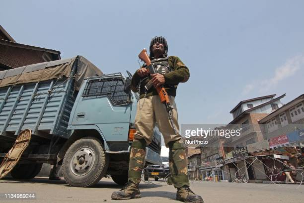 An Indian soldier stands alert during restrictions in SrinagarKashmir on April 05 2019Massive overnight clashes broke out in Central Jail Srinagar...