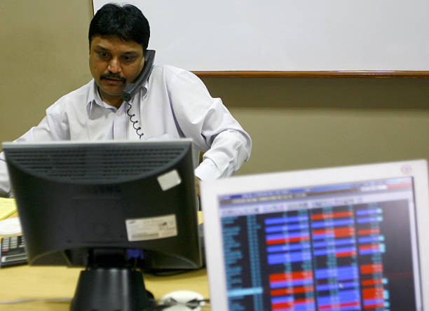 An Indian Stock Trader Speaks On A Telep