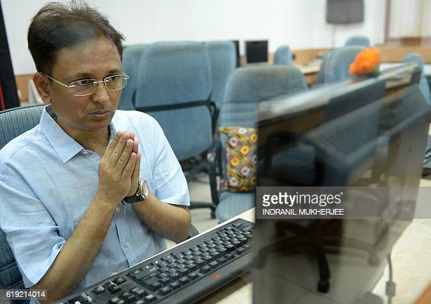 An Indian stockbroker poses for a photograph as he prays before the start of Muhurat Trading a special trading session on the occasion of Diwali the...