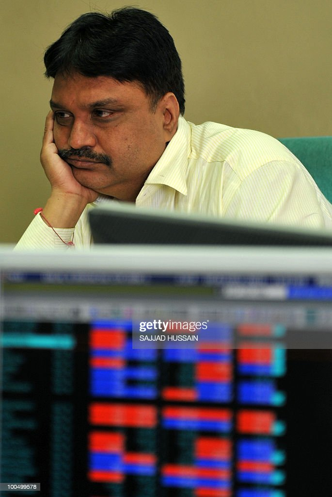 An Indian stockbroker reacts at a brokerage firm in Mumbai on May 25, 2010. Indian shares fell over three percent intraday, to a three-month-low of below 16,000 points level, as foreign funds sold riskier equities amid a deepening to Europe's debt woes.The benchmark 30-share Sensex index was down 509.4 points to a day's low of 15,960.15, half an hour prior to its close. AFP PHOTO/Sajjad HUSSAIN