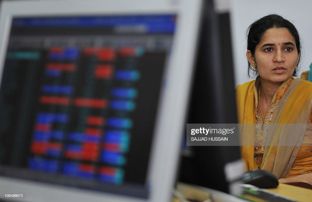 An Indian stockbroker trades at a brokerage firm in Mumbai on May 25, 2010. Indian shares fell over three percent intraday, to a three-month-low of below 16,000 points level, as foreign funds sold riskier equities amid a deepening to Europe's debt woes.The benchmark 30-share Sensex index was down 509.4 points to a day's low of 15,960.15, half an hour prior to its close. AFP PHOTO/Sajjad HUSSAIN