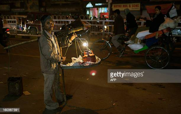 An Indian street vendor sells food in the Old Quarters in New Delhi on January 30 2013 Emerging economies are set to grow faster than the developed...
