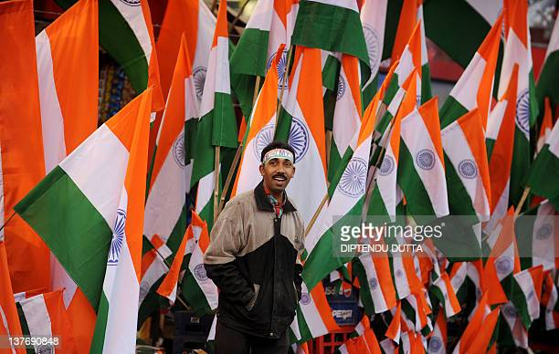 An Indian street vendor wait for customers to sell Indian national flags in Siliguri on January 25 2012 on the eve of India's Republic Day...