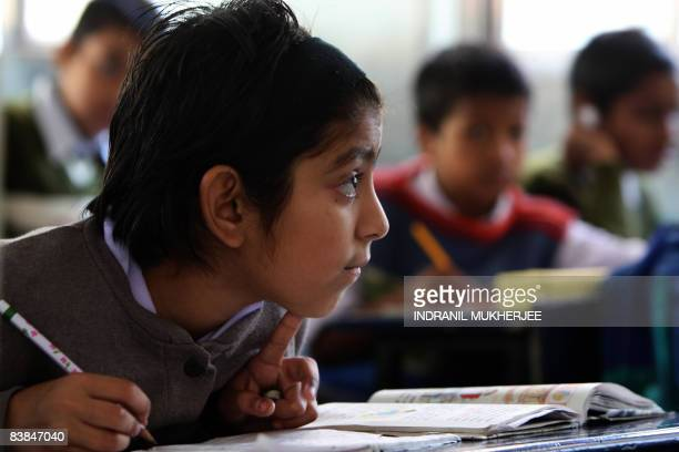 An Indian student attends class at Gokul the Manavya foundation residential school for HIV positive children in Bhoogaon some 175 kms Northeast of...