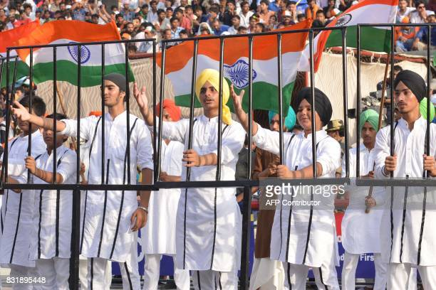 An Indian student dressed as Indian freedom fighter Bhagat Singh perform during a ceremony to mark India's 70th Independence Day celebrations at the...