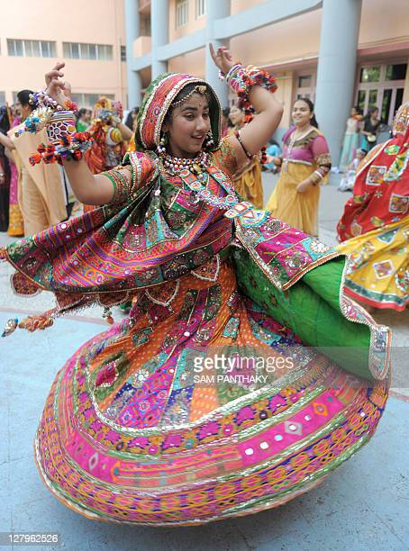 An Indian student participates in a traditional dance during the Navratri festival in Ahmedabad on October 1 2011 Navratri or Festival of Dance...