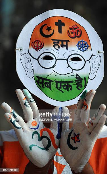An Indian student poses prior to attending a peace rally on the 64th death anniversary of India's father of the nation Mohandas Karamchand Gandhi or...