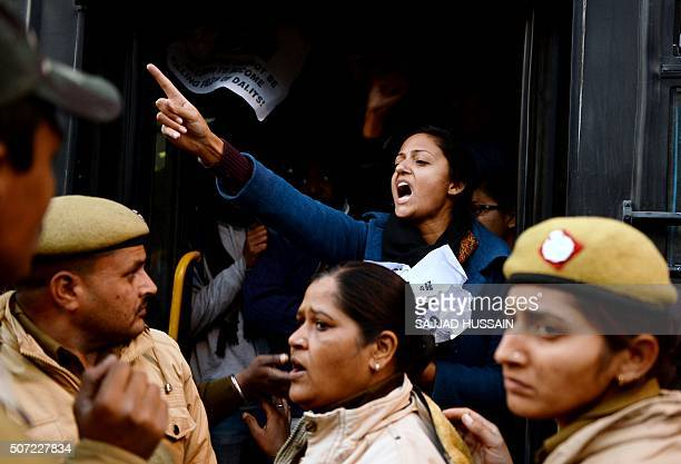 An Indian student shouts slogans from a bus after she and others were detained by Indian police outside the office of Indian Minister of Human...