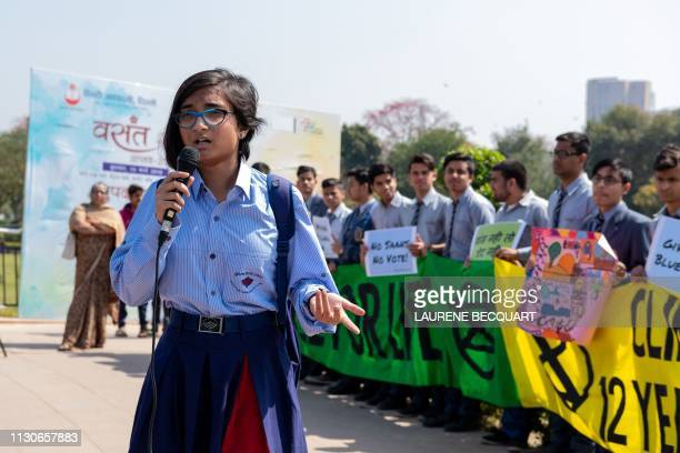 An Indian student speaks as she participates in a school strike called 'Fridays for future' to protest against climate change in New Delhi on March...