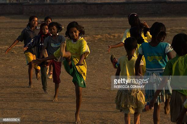 An Indian student takes part in a practice session alongside players aged 612 from 'The Masters' and 'The Little Masters' Yuwa School football...