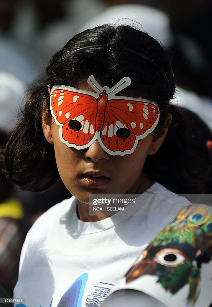 An Indian student wearing a red butterfly mask takes part in a World Environment Day 'Green Rally' in Hyderabad on June 5, 2010. This year the theme of World Environment Day is 'Many Species. One Planet. One Future?'AFP PHOTO/Noah SEELAM