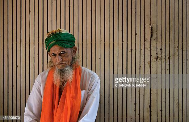An Indian sufi fakir seeks alms on the street near a dargah in New Delhi on August 26 2014 The presence of Sufism in India for more than 1000 years...