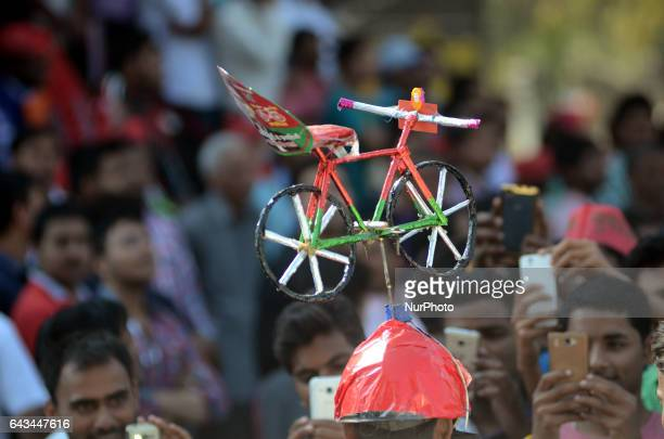 An indian suporter of Samajwadi Party wearing the cap with party's symbol cycle during the combined election campaign of Akhilesh Yadav and and Rahul...