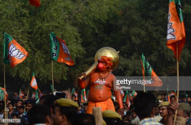 An indian supporter of Bhartiya Janta Party dressed as Hindu monkey faced God Hanuman listens to the speech of Uttar Pradesh state Chief Ministe...