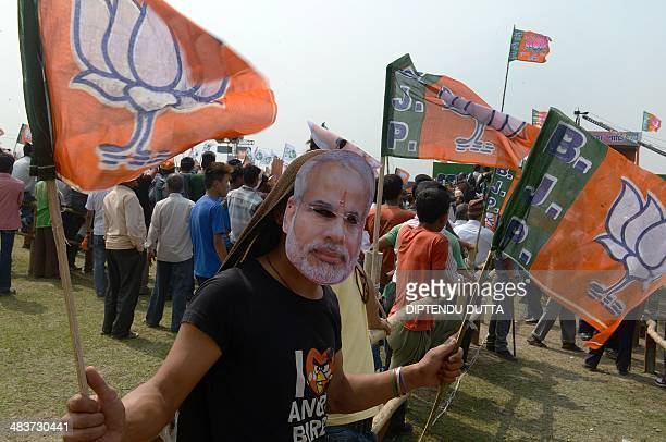 An Indian supporter of Chief Minister of the western Gujarat state and Bharatiya Janata Party Prime Ministerial candidate Narendra Modi wears a Modi...