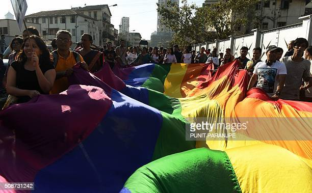 An Indian supporter of the lesbian gay bisexual and transgender community holds a placard during a Pride March in Mumbai on February 6 2016 India's...